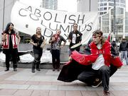 Tribal members from the Old Growth Alliance, including dancer Keet Dugeen a newly adopted member of the Tlingit nation, rally against Columbus Day in Westlake Park adjacent to the Occupy Seattle supporters.  The Old Growth Alliance voiced its support of Occupy Seattle at their rally.