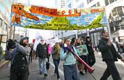 Several hundred Occupy Seattle protesters march down Second Avenue Monday afternoon on the way from Westake Park to the Port of Seattle, where they planned to take part in the Occupy movement's attempted West Coast Port Shutdown.