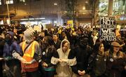 Occupy Seattle protesters link arms earlier this month in downtown Seattle.