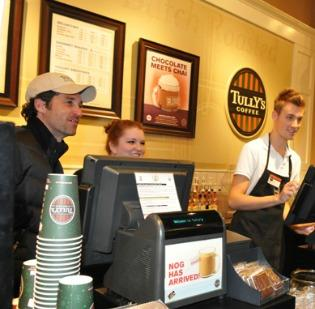 An investment group led by actor Patrick Dempsey, at left with Tully's employees, has completed its purchase of the Tully's coffee shop chain.