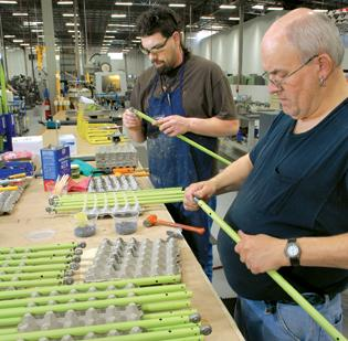 Steve Neitzel, right, assembles aircraft control rods alongside Thomas Bagwell at the Primus facility in Woodinville.