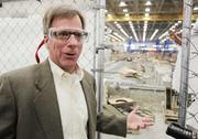 """Eric Lindblad, vice president of 737 jetliner manufacturing operations, wears protective eyewear while showing 737s being assembled in Renton. To meet Boeing's goal of record production, he said, """"you have to have the equipment required, tooling capacity, you have to have people to do that work, and you have to have space."""""""