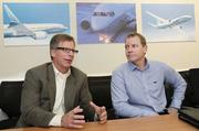 Eric Lindblad (left) 737 jetliner Manufacturing Operations Vice President and Barry Lewis, 737 jetliner Director of Wings Manufacturing speak during an interview at the company's manufacturing facilities as the company ramps up 737 production in Renton, Washington on December 6, 2012.