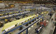 Boeing employees work on the 737 jetliner wing-production line in Renton, Washington on December 6, 2012.