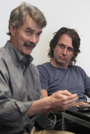 Pearl Jam guitarist Stone Gossard (right) listens while Forterra President Gene Duvernoy speaks during an interview in Seattle on Wednesday.