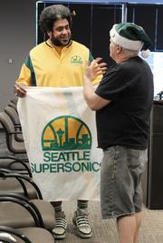 """Bring back our Sonics"" founder Dr. David Brown (right) speaks with supporter Kris ""Sonics Guy"" Brannon before a press conference with Seattle sports arena investor Chris Hansen, Seattle mayor Mike McGinn and King County Executive Dow Constantine on Wednesday."