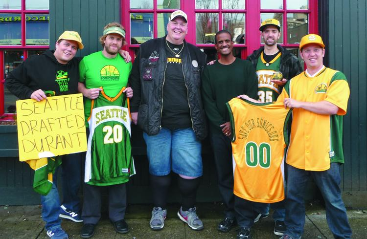 "Robinson during his ""Save Our Sonics"" days. From Left, Sonicsgate Executive Producer Collin Baxter, Sonicsgate Director Jason Reid, Superfan Lorin ""Big Lo"" Sandretzky, David Aldridge from TNT and the NBA Channel, Sonicsgate Producer Adam Brown, and Brian Robinson, co-founder of Save our Sonics."