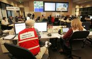 Deputy EOC director Laurel Nelson (right) and Grant Tietje, operations section chief work in the City of Seattle Emergency Operation Center (EOC) on Thursday.