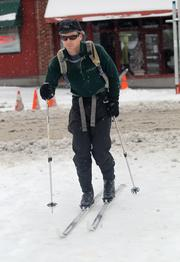 Josh Wozniak cross-country ski-commutes to work in downtown Seattle as snow continued to fall in the city on Thursday.
