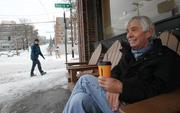 Don Shivers of Seattle drinks a latte at Cafe Ladro in the Queen Anne neighborhood in Seattle amidst freezing temperatures on Thursday.