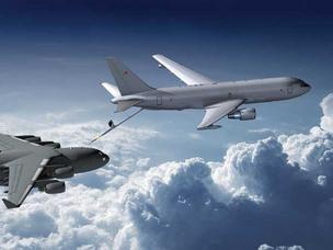 Production of Boeing's KC-46 Air Force tanker, pictured here as it would look refueling a plane, could potentially be trimmed back by defense cuts.