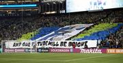 Seattle Sounders south end zone supporters groups unveil a giant banner depicting goalkeeper Kasey Keller.