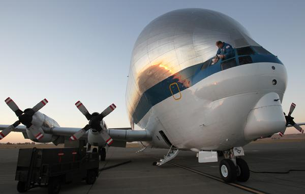 NASA  maintenance contractor James Isley cleans the pilot windows of NASA's Super Guppy as it sits on the tarmac at Travis Air Force Base in Northern California early Thursday. The specialized cargo aircraft carried the forward section of the space shuttle trainer to  the Museum of Flight in Seattle.