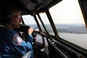 """NASA astronaut Ken """"Taco"""" Cockrell pilots the Super Guppy over the Puget Sound on its way to Seattle on Thursday."""