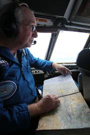 NASA flight engineer Henry Taylor assists in navigating the Super Guppy as it carries a section of the space shuttle trainer bound for the Museum of Flight in Seattle.