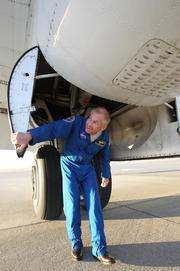 """NASA astronaut and pilot Ken """"Taco"""" Cockrell inspects the Super Guppy before its flight Thursday from Travis Air Force Base in Northern California."""