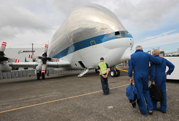"NASA pilot Rick ""Train"" Hull (left) and fellow pilot Ken ""Taco"" Cockrell on the tarmac at Seattle's Boeing Field after flying NASA's Super Guppy from Travis Air Force Base in California, delivering the last part of the space shuttle trainer that is being installed at the Museum of Flight. (See video below.)"