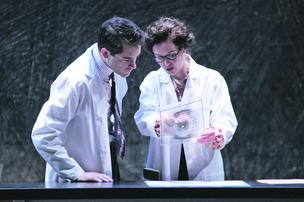 "Seattle Repertory Theatre's ""Photograph 51,"" which tells the story of British scientist Rosalind Franklin, stars Brian Earp and Kirsten Potter, above. The theater extended the show's run after local companies including Dendreon bought out entire nights for their employees to attend."