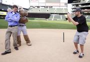 As part of the 2012 Washington's Best Workplaces Awards at Safeco Field in Seattle, attendees got to run the bases, take a turn at bat and, as Charles Seybold (left) and Evan Hill of Liquid Planner did,  get their photos take with the Mariner Moose.