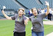 Michele Livingston, left, and Danielle Burd, both of Umpqua Bank participated in the Parade of Companies at Safeco Field as part of Puget Sound Business Journal's 2012 Washington's Best Workplaces Awards.
