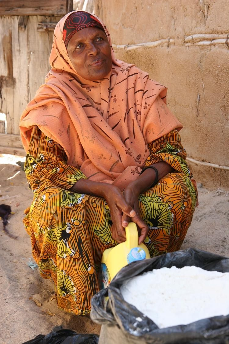 In Dhobley, Somalia, Halima Maalim Sugal holds sugar and oil she received from World Concern. The nonprofit is using technology developed by Seattle-based startup ScanMyList to improve tracking and distribution of aid.