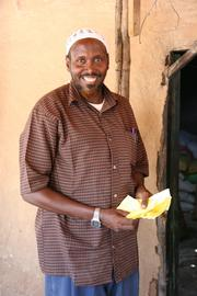 A Somali merchant holds paper vouchers he will redeem through World Concern to be reimbursed for food he distributed to hungry families.