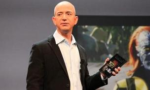 "Amazon CEO Jeff Bezos with a Kindle Fire. Amazon is among ""The Gang of Four"" innovators in the mobile banking and payment space, according to a new report."