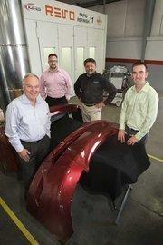 From left, Ian McIntosh, Brian Cronk, Leonard Lassak and Sean McIntosh (son of Ian) run the high-tech Kirmac collision repair facility in Tacoma.