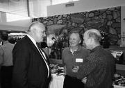 Bob Dickson, left, attends a function at a Frontier branch in Bellingham. When regulators closed it, the bank had 51 offices in Washington and Oregon and $3.6 billion in assets.