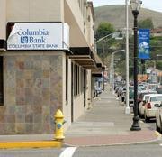 A temporary sign from new owner Columbia State Bank covers the former headquarters of the Columbia River Bank. It was one of the largest employers in The Dalles, Ore.