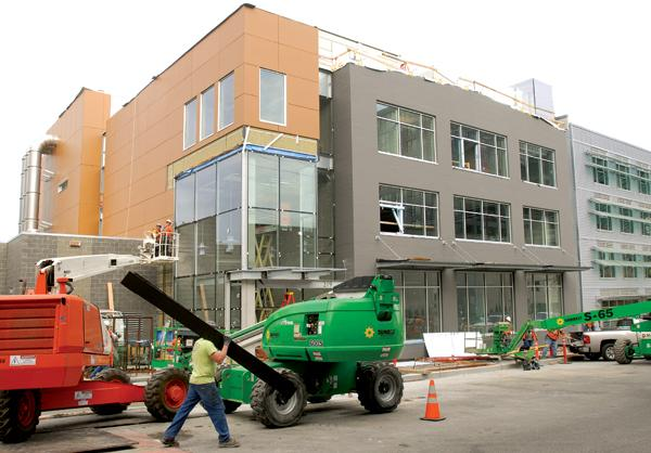 Construction crews prepare the old warehouse at 219 Terry Ave. N. in Seattle for its new use as biotech labs. Even before the renovation is complete, the building in the South Lake Union area, a hotbed of life sciences and tech companies, is fully leased.