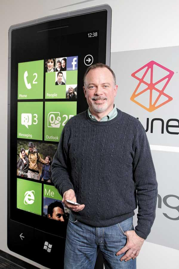 Greg Sullivan, senior product manager with Windows Phones, orchestrates Microsoft's attempt to dramatically boost its 5 percent smartphone market share. He works from the company's Redmond offices, where a larger-than-life Windows Phone image graces a wall.