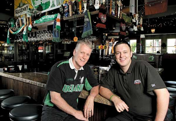 From left, Shawn O'Donnell and Shawn O'Donnell Jr. say their family's Everett restaurant may not be able to expand because that would trigger mandatory health coverage for employees under the Affordable Care Act.