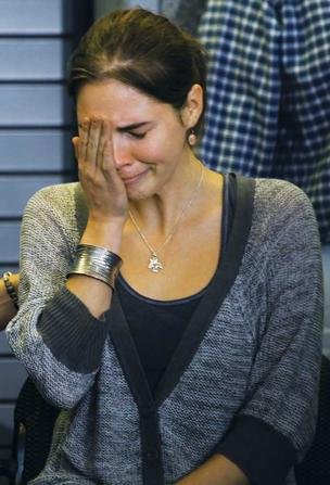 Amanda Knox breaks down at Seattle-Tacoma International Airport the day  after an Italian judge overturned her conviction in her roommate's  murder.