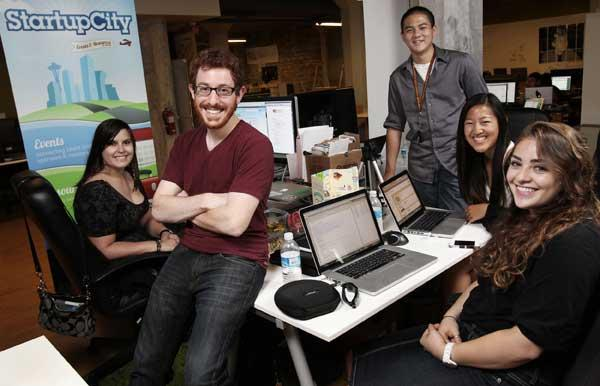 StartupCity founder Red Russak (second from left) modeled an internship program after the entrepreneur-in-residence model. Newly hired interns (left to right) Molly Donnelly, Andrew Tat, Sylvia Xu and Shira Genauer work out of the Founders Co-op in the South Lake Union neighborhood and will create their own company as part of the program.