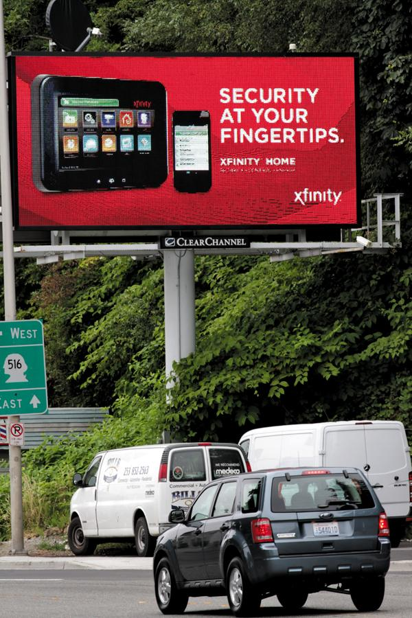 An LED billboard in Kent displays an ad for Xfinity. The sign can change every eight seconds.