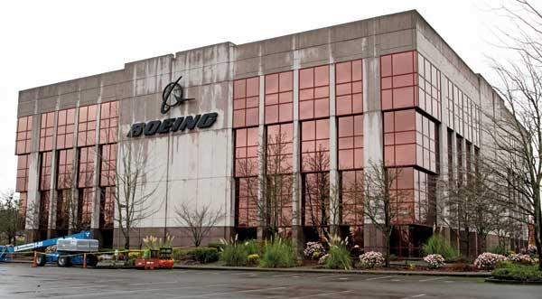 "Boeing is selling 72 acres of the Boeing Space Center in Kent, including this ""Pink Palace"" building and six others. The buyer plans to redevelop the site as an industrial park."