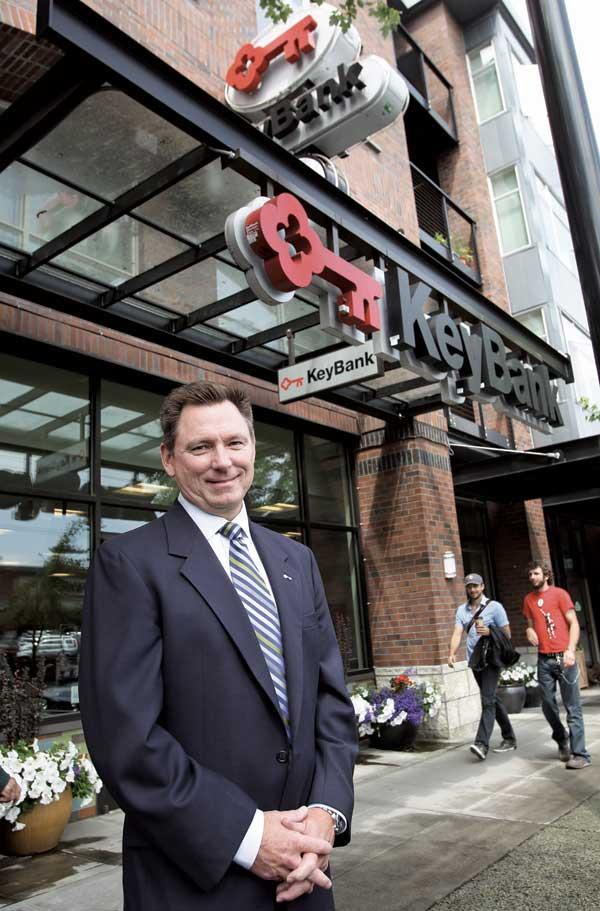 Rick Wirthlin, president of KeyBank's Seattle Cascades District, says a struggling retail market has helped the bank find new locations. He's seen here at a 2-year-old Queen Anne branch.