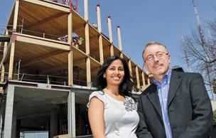 "Bullitt Foundation program officers Neelima Shah and Steven Whitney visit the construction site of the new headquarters on Seattle's Capitol Hill, billed by the foundation as ""the greenest commercial building in the world."""