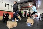 Rosen Properties employees (left to right, in foreground) Erin Latta, Melody Warouw, Mimi Rosen and Georgina Murphy work out during a staff session at Crossfit 425 in Bellevue.