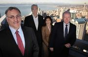 "From left, Plaza Bank President and CEO Mike Paul, Executive Vice President A.R. ""Gus"" Ayala, Senior Vice President Rosario Arias de Carroll and Senior Vice President Michael Clabby gather on the deck of the bank's headquarters overlooking downtown Seattle."