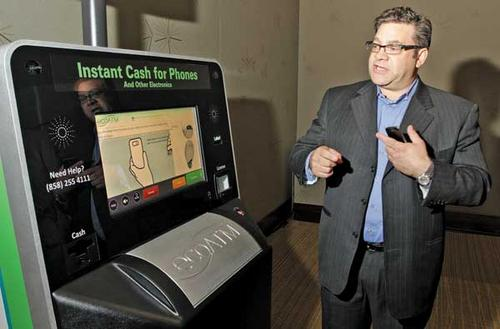 Coinstar's new kiosks: From fancy photo booths to phone recycling