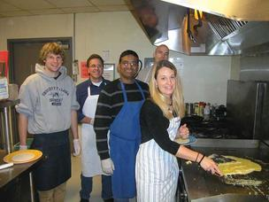 Point B employees and friends serve breakfast at New Horizons. From left, Jacob Olmstead, Bob Hawkinson, Kumar Anbalagan, John Carroll and Angie Bruemmer.