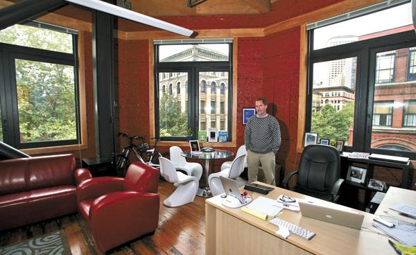 Discovery Bay Games CEO Craig Olson has a panoramic view of Pioneer Square from his office on the third floor of the Buttnick Building. Discovery Bay Games recently expanded onto the building's second floor as well.  On Olson's desk is the company's recently released Atari Arcade, which lets users play the greatest hits of Atari arcade games on an iPad.