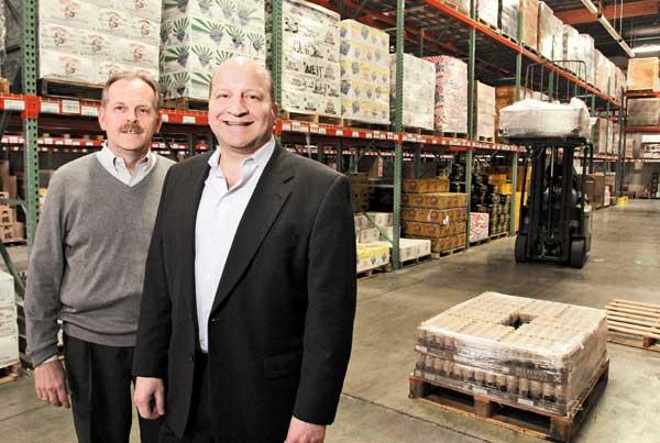 Click Wholesale Distributing CFO Lance Herberg (left) and President Rick Steckler (right) are looking for new sales staff and suppliers.