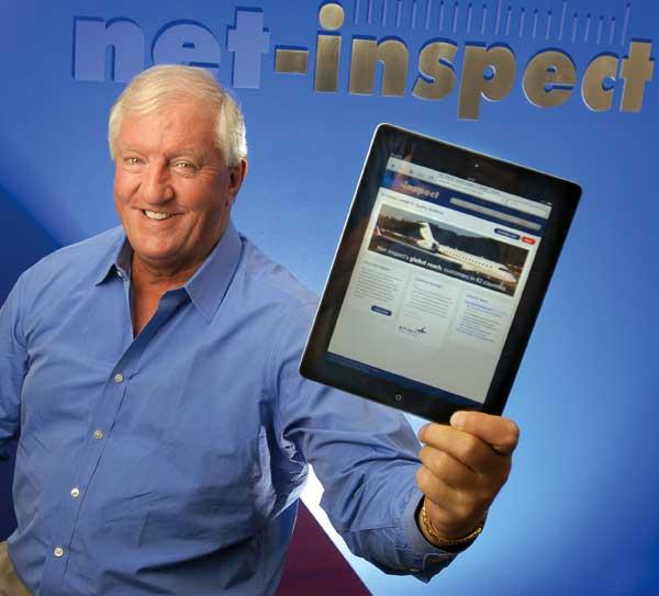 Net-Inspect CEO Mike Dunlop, showing his company's website, expects to double last year's revenue.