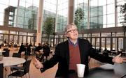 "Raikes talks about idealism and management in the atrium of the Gates Foundation's headquarters, in Seattle. Idealism is a great motivator, but as Raikes points out, ""if we manage people more effectively, we'll save more lives."""