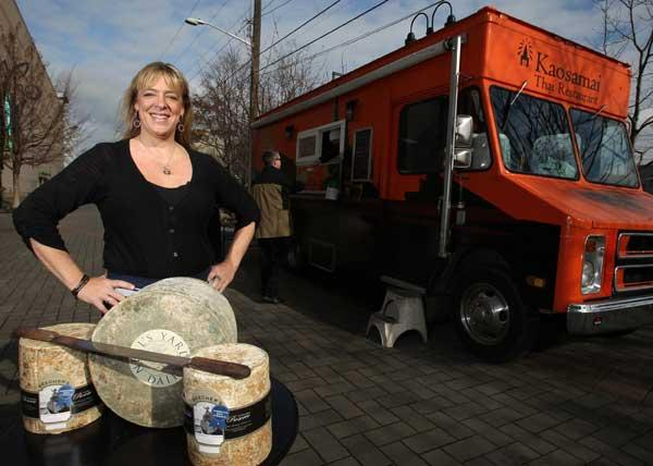 Chef Danielle Custer, shown here with blocks of cheese near a food truck parked in the Seattle's Sodo district, has left the Seattle Art Museum's Taste restaurant to open Mobile Monte Cristo this spring. She has corporate backing for the food-truck business, which will serve gourmet grilled cheese sandwiches and other fare.