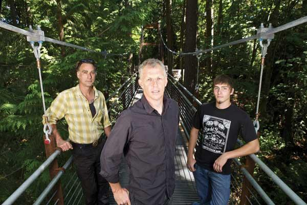 From left, Ken Gilman, Marty Walz and Austin Thompson of Seattle Bridge pose on the Ravine Experience suspension bridge constructed by their company at Bellevue Botanical Gardens in Bellevue. (Not pictured, Adam Peck.)