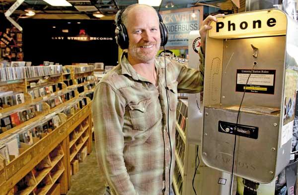 Matt Vaughan, President of Easy Street Records at one of the former pay-phones turned listening booths at his Queen Anne location.